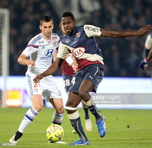 Girondin's forward Cheick Diabate vies with Lyon's midfielder Maxime Ganalons during the French L1 football match between Bordeaux and Lyon on...