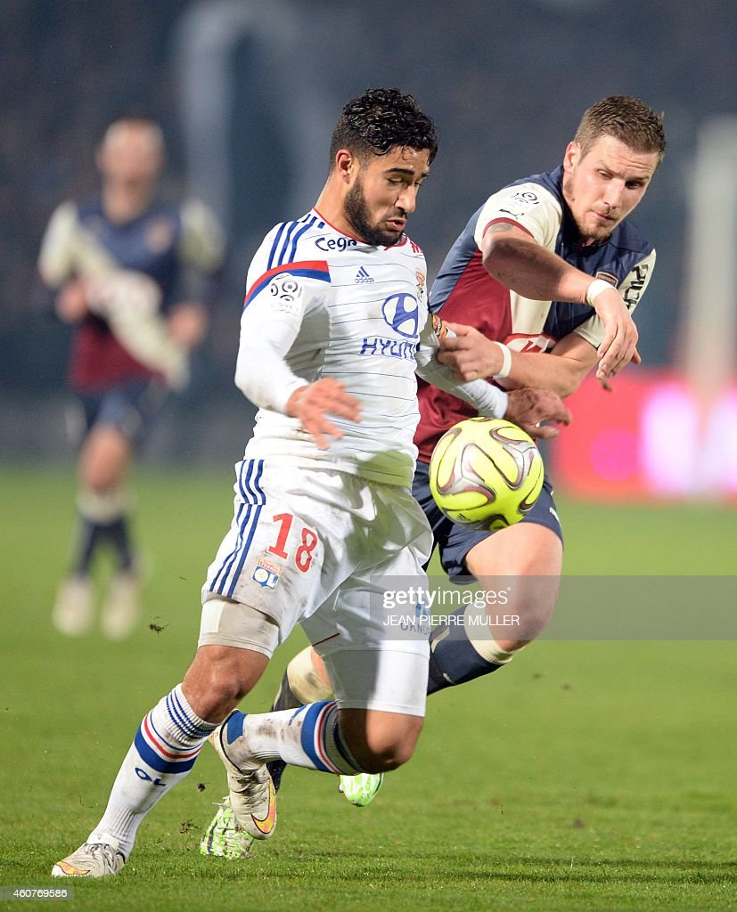 Girondin's midfielder <a gi-track='captionPersonalityLinkClicked' href=/galleries/search?phrase=Gregory+Sertic&family=editorial&specificpeople=5853019 ng-click='$event.stopPropagation()'>Gregory Sertic</a> vies with Lyon's midfielder Nabil Fekir during the French L1 football match between Bordeaux (FCGB) and Lyon (OL) on December 21, 2014 at the Chaban-Delmas Stadium in Bordeaux, southwestern France.