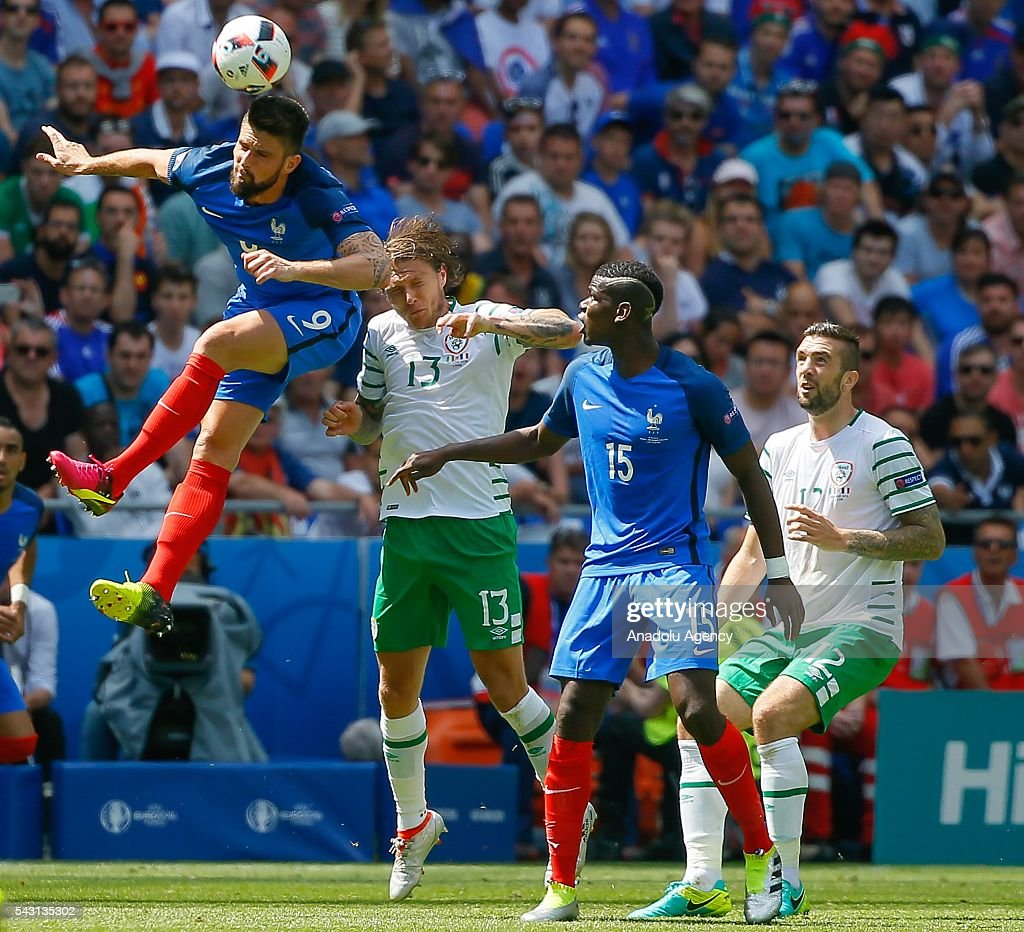 Giroud (9) and Pogba (15) of France in action against Hendrick (13) and Duffy (12) of Ireland during the UEFA Euro 2016 Round of 16 football match between France and Ireland at the Stade de Lyon in Lyon, France on June 26, 2016.