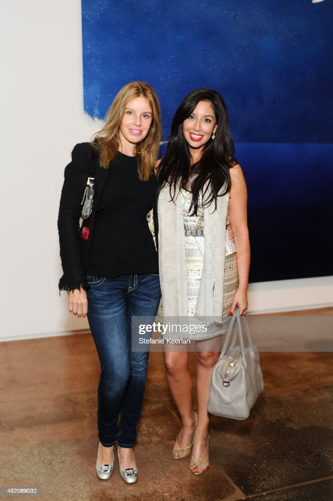 Gisela Colon and Veronica Fernandez attend Joe Goode 'Flat Screen Nature' on July 12, 2014 in Los Angeles, California.