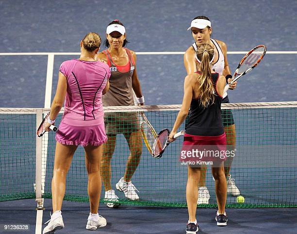 Gisela Dulko of Argentina and Nadia Petrova of Russia as well as YungJan Chan of Chinese Taipei and Kimiko Date Krumm of Japan greet each other after...