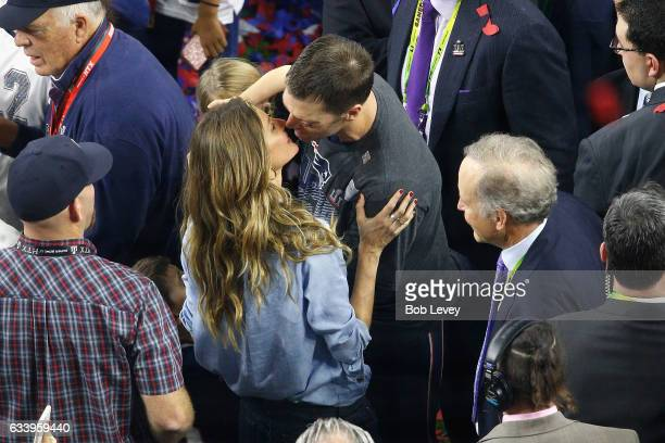 Gisele Bündchen and Tom Brady of the New England Patriots celebrate after defeating the Atlanta Falcons 3428 in overtime during Super Bowl 51 at NRG...