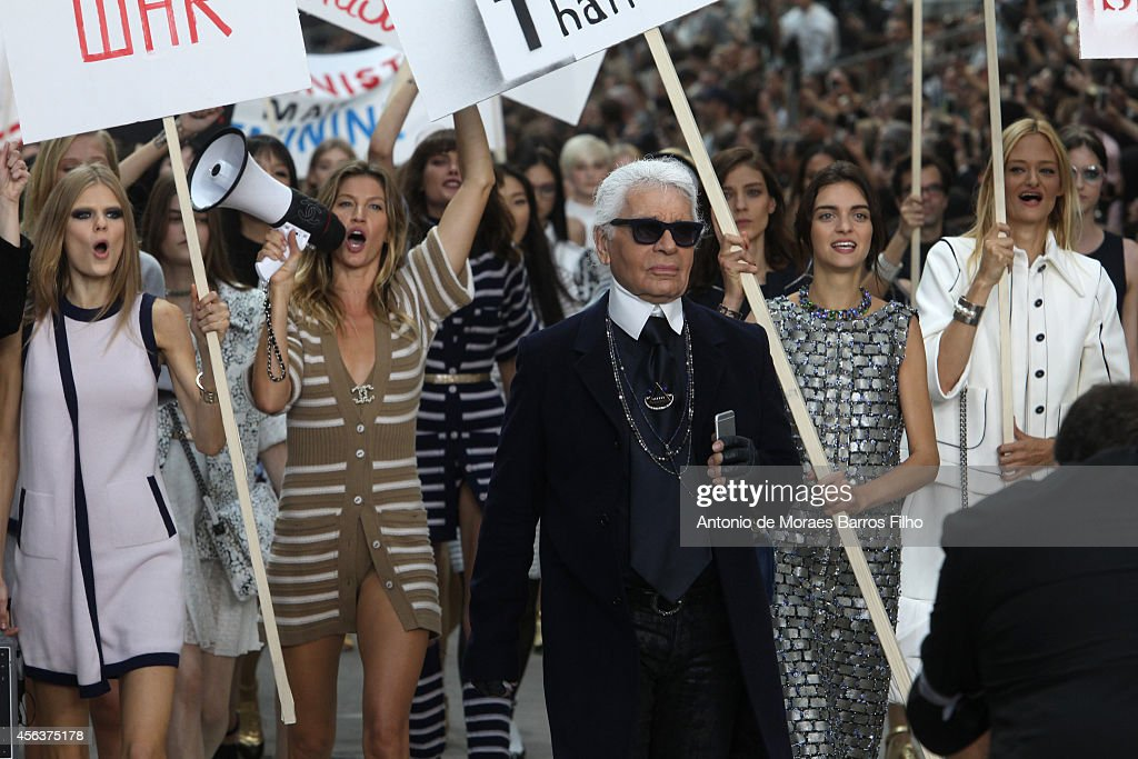 Gisele Bündchen Karl Lagerfeld walks the runway during the Chanel show as part of the Paris Fashion Week Womenswear Spring/Summer 2015 on September...