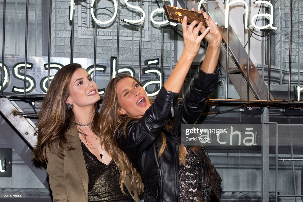 Gisele Bundchen (R) and Camila Queiroz attend Rosa Cha presents Gisele Bundchen on August 16, 2017 in Sao Paulo, Brazil.