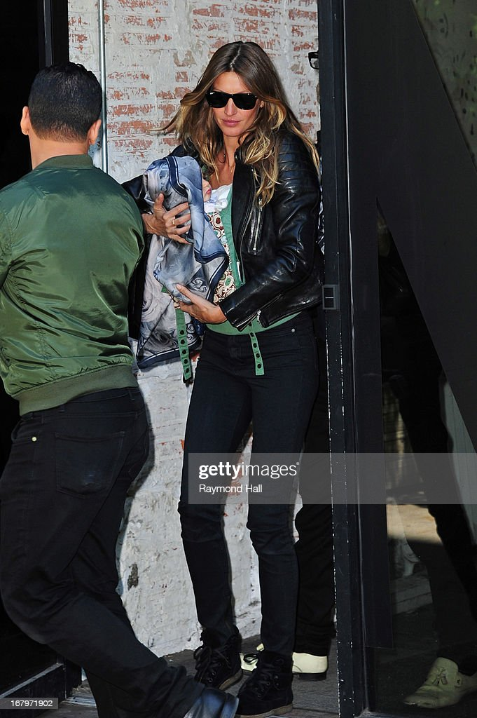 Gisele Bundchen carries her daughter Vivian Lake Brady in SoHo on May 3, 2013 in New York City.