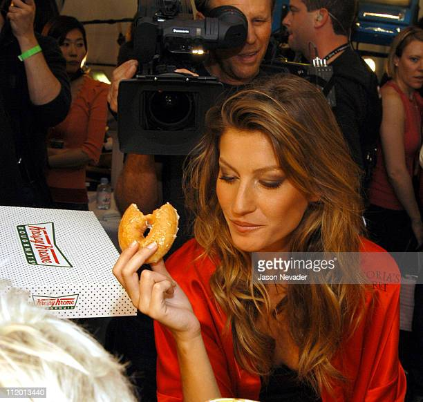 Gisele Bundchen eats a Krispy Kreme donut during 9th Annual Victoria's Secret Fashion Show Hair and Makeup at The New York State Armory in New York...