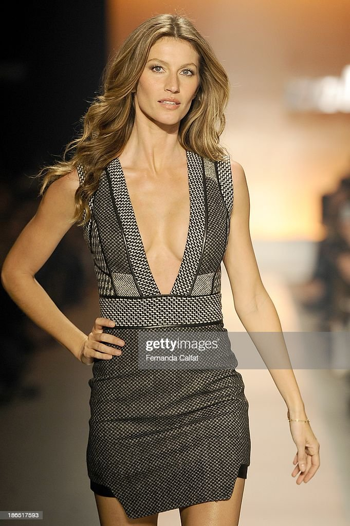 Gisele Bundchen walks the runway during Colcci show at Sao Paulo Fashion Week Winter 2014 on October 31, 2013 in Sao Paulo, Brazil.