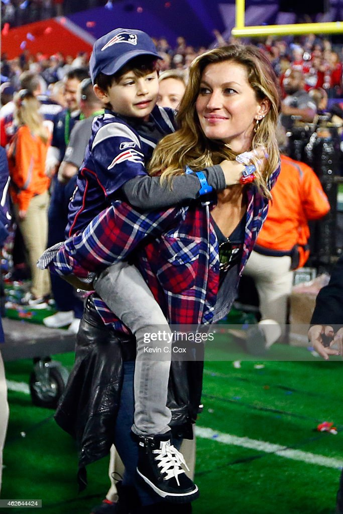<a gi-track='captionPersonalityLinkClicked' href=/galleries/search?phrase=Gisele+Bundchen&family=editorial&specificpeople=201815 ng-click='$event.stopPropagation()'>Gisele Bundchen</a>, wife of Tom Brady #12 of the New England Patriots, walks on the field with their son, Benjamin after defeating the Seattle Seahawks during Super Bowl XLIX at University of Phoenix Stadium on February 1, 2015 in Glendale, Arizona. The Patriots defeated the Seahawks 28-24.