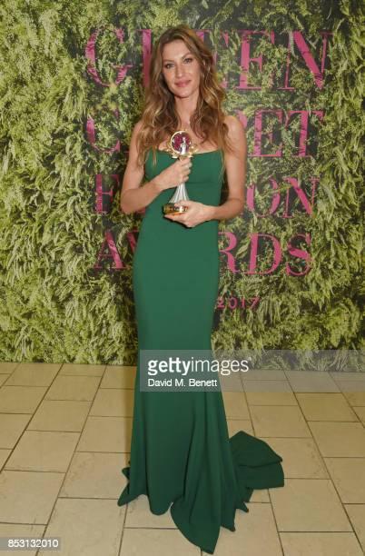 Gisele Bundchen winner of The Vogue Eco Laureate Award poses backstage at The Green Carpet Fashion Awards Italia at Teatro Alla Scala on September 24...