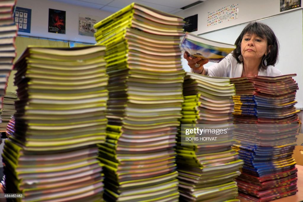 Gisele Herrat, in charge of the library of the college du Roy d'Espagne, sorts out text books in Marseille, southern France, on September 1, 2014, on the eve of the new school year.