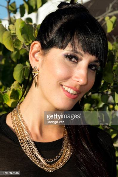 Giselle 'Gigi' Ojeda poses for portraits at H2O Music Festival at Los Angeles Historical Park on August 17 2013 in Los Angeles California