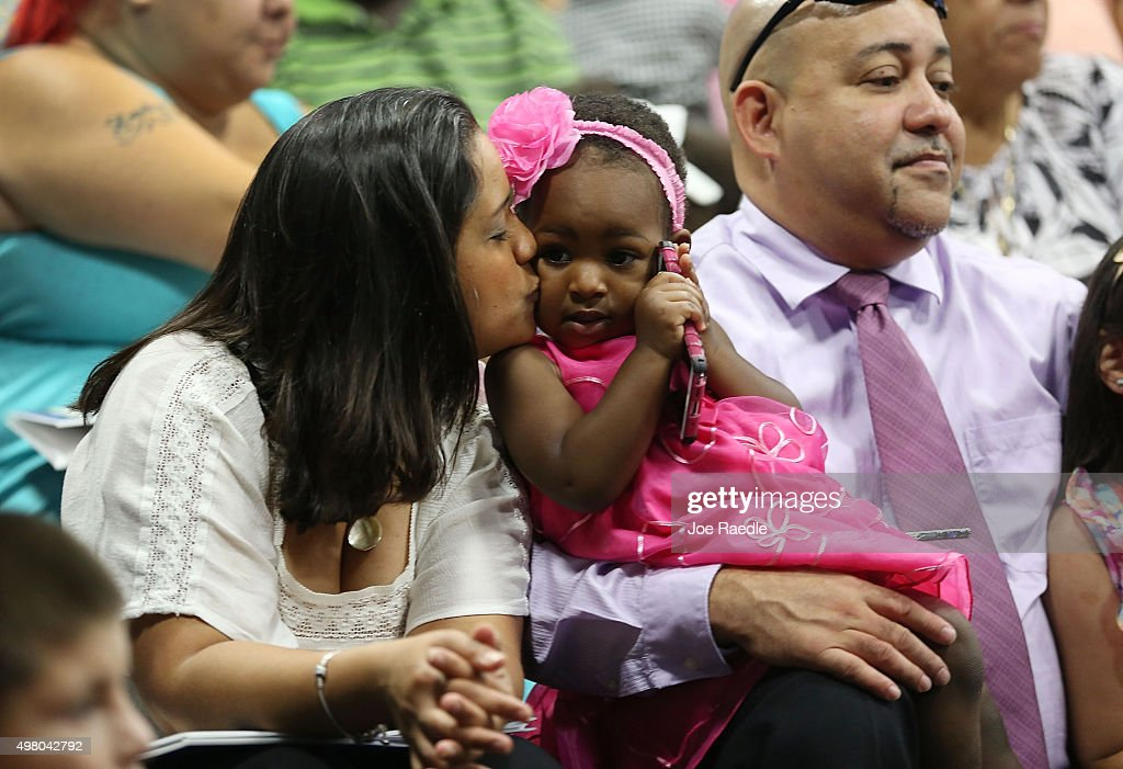 National adoption day marked at miami childrens museum photos and giselle malagon l kisses alyssa malagon as she and her husband victor malagon ccuart Choice Image
