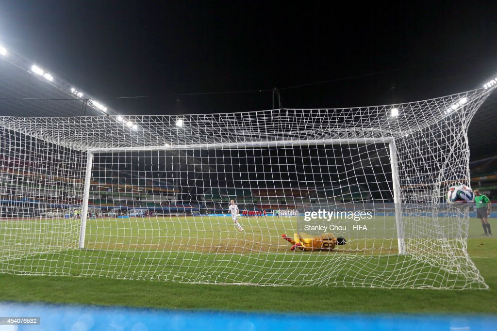 Gisli Kristjansson of Iceland scores in the penalty shoot out after full time 1-1 draw during the 2014 FIFA Boys Summer Youth Olympic Football Tournament Semi Final match between Korea Republic and Iceland at Jiangning Sports Centre Stadium on August 24, 2014 in Nanjing, China.