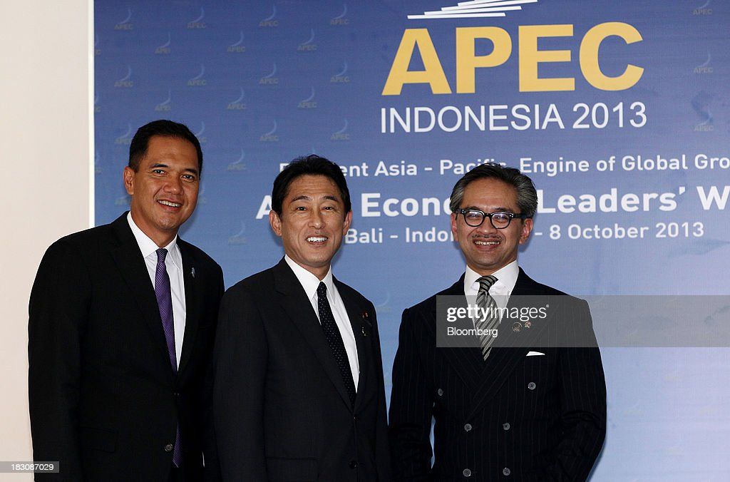 Gita Wirjawan, Indonesia's trade minister, left, Fumio Kishida, Japan's foreign minister, center, and <a gi-track='captionPersonalityLinkClicked' href=/galleries/search?phrase=Marty+Natalegawa&family=editorial&specificpeople=2862416 ng-click='$event.stopPropagation()'>Marty Natalegawa</a>, Indonesia's foreign minister, pose for photographs ahead of the Asia-Pacific Economic Cooperation (APEC) Ministerial Meeting in Nusa Dua, Bali, Indonesia, on Friday, Oct. 4, 2013. Asia-Pacific leaders will seek momentum on talks for a sweeping 12-nation trade pact when they meet in Bali in coming days, trying to overcome concessions sought by countries that threaten to further delay completion. Photographer: SeongJoon Cho/Bloomberg via Getty Images