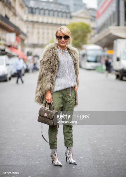 Gitta Banko wearing a grey sweater by Thom Krom khaki pants by Citizen of Humanity olive green fake fur jacket by True Religion silver colored...