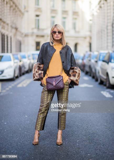 Gitta Banko wearing a mustard colored sweater from Mango brocade jacket with fake fur trimming in leopard pattern by Steffen Schraut pants with...