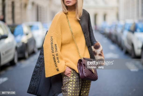 Gitta Banko wearing a mustard colored sweater from Mango with the print be yourself everybody else is taken brocade jacket with fake fur trimming in...
