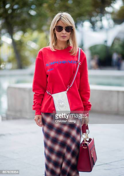 Gitta Banko wearing a red cotton sweater by Wodka Ogurez checked cotton skirt with train by Dsquared 2 red leather ankle boots and red Runaway...