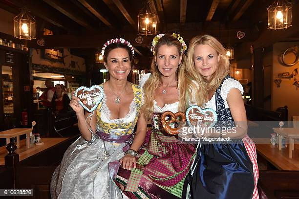 Gitta Saxx Giulia Siegel and Sonja Kiefer attend the Charity Lunch at 'Zur Bratwurst' during the Oktoberfest 2016 on September 27 2016 in Munich...