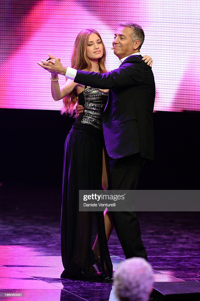 Giulia Arena and Massimo Ghini attend the 2013 Miss Italia beauty pageant at the Pala Arrex on October 27, 2013 in Jesolo, Italy.