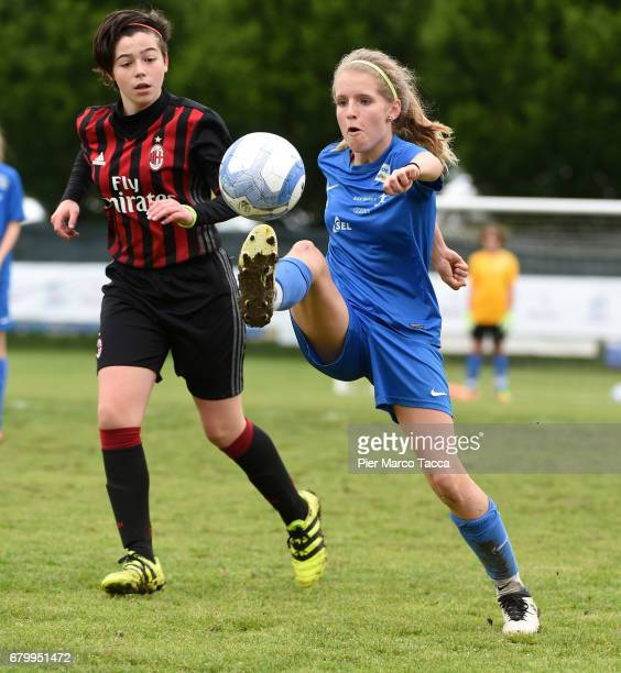 Giulia Avallone of AC Milan Women Under 12 competes for the ball with Elisa Pfattner of SSV Brixen obi Women Under 12 during the match between AC...