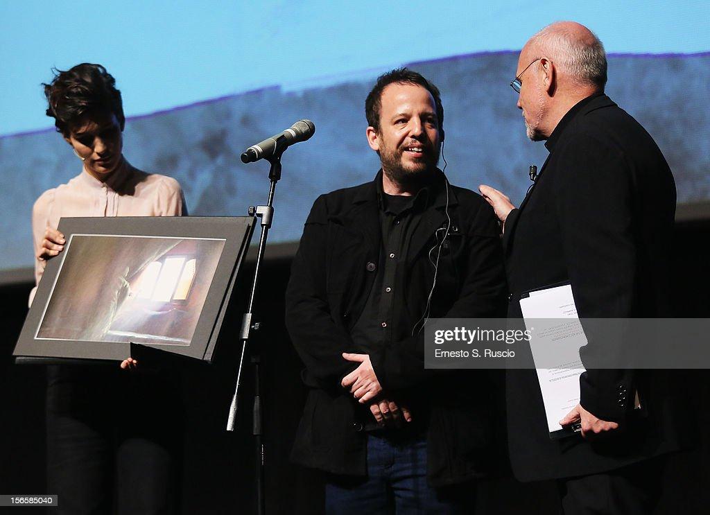 <a gi-track='captionPersonalityLinkClicked' href=/galleries/search?phrase=Giulia+Bevilacqua&family=editorial&specificpeople=4486077 ng-click='$event.stopPropagation()'>Giulia Bevilacqua</a> (L) and Rome Film Festival director <a gi-track='captionPersonalityLinkClicked' href=/galleries/search?phrase=Marco+Muller&family=editorial&specificpeople=829966 ng-click='$event.stopPropagation()'>Marco Muller</a> (R) on stage with director Alejo Hoijman, winner of the Enel Cuore Al Cinema Sociale award for the movie 'El Ojo del Tiburon' during the Collateral Awards Ceremony at the 7th Rome Film Festival at the Auditorium Parco Della Musica on November 17, 2012 in Rome, Italy.