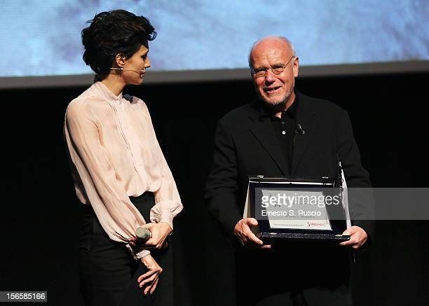 Giulia Bevilacqua and Rome Film Festival Director Marco Muller pose on stage with the 'Excellence for Cinema and Entertainment' Award during the...