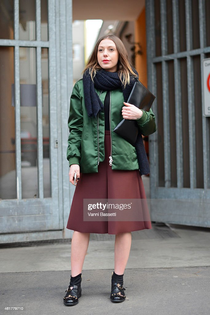 Giulia Capresi poses wearing an Acne bomber H and M skirt Carlo Pazolini shoes and N21 clutch during day 3 of Milan Menswear Fashion Week Fall/Winter...
