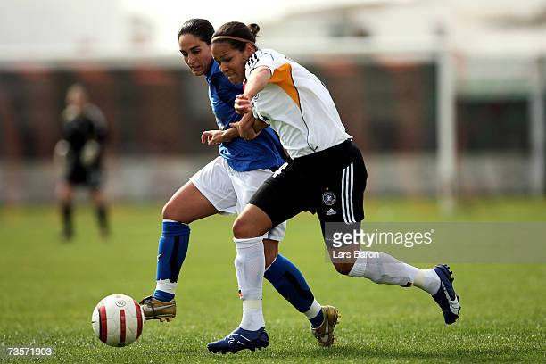 Giulia Domenichetti of Italy tackles Celia Okoyino da Mbabi of Germany during the Algarve Cup 7th place match between Germany and Italy at Stadio...
