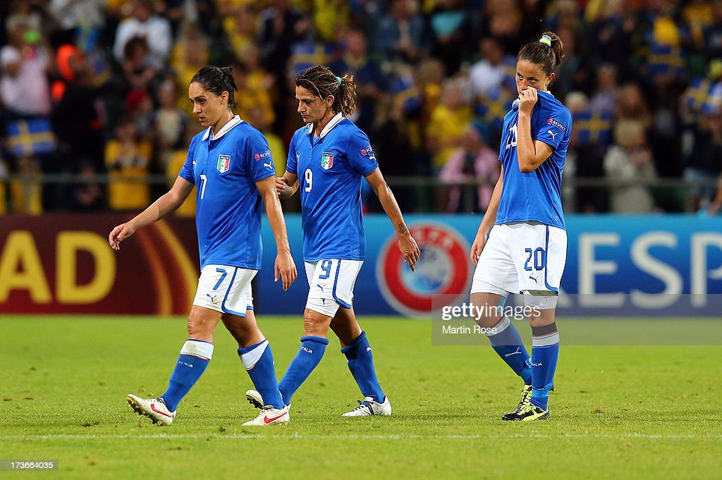 Giulia Domenichetti, Patrizia Panico and Raffaelle Manieri of Italy walks off dejected after the UEFA Women's Euro 2013 group A match between Sweden and Italy at Orjans Vall on July 16, 2013 in Halmstad, Sweden.