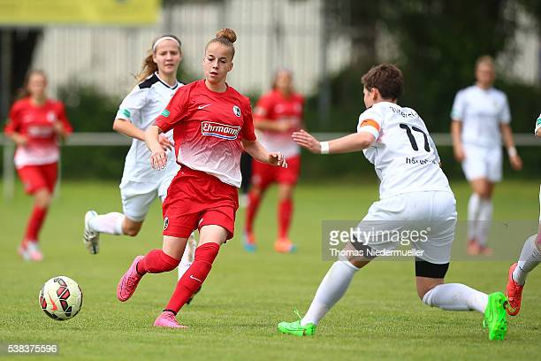 Giulia Gwinn of Freiburg fights for the ball with Svenja Hoerenbaum of Guetersloh during U17 Girl's German Championship semi final first leg at...