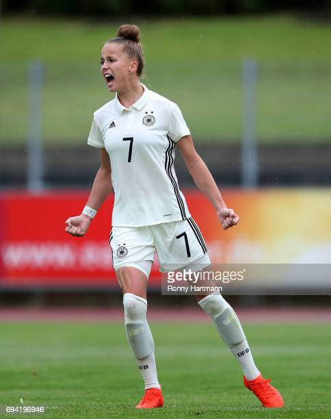 Giulia Gwinn of Germany celebrates after scoring her team's opening goal during the U19 women's elite round match between Germany and Switzerland at...