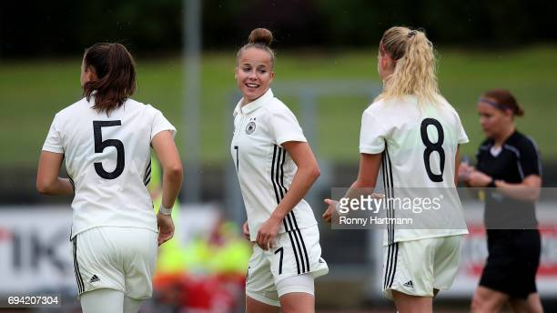 Giulia Gwinn of Germany celebrates after scoring her team's opening goal with Tanja Pawollek and Kim Fellhauer of Germany during the U19 women's...