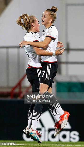 AZ ZARQA' JORDAN OCTOBER 07 Giulia Gwinn of Germany celebrates with team mate Sydney Lohmann after scoring her team's first goal during the FIFA U17...