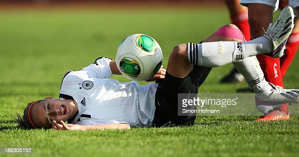 Giulia Gwinn of Germany is challenged during the Girls U15 international friendly match between Germany and Scotland on October 30 2013 in Muehlheim...