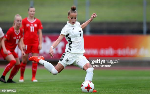 Giulia Gwinn of Germany scores her team's opening goal during the U19 women's elite round match between Germany and Switzerland at Friedensstadion on...