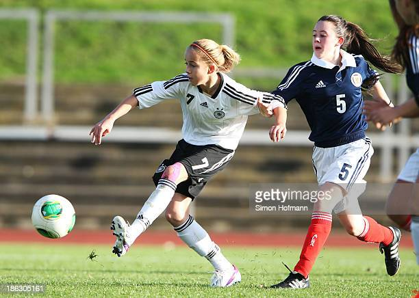 Giulia Gwinn of Germany tries to score against Nina Fitzsimmons of Scotland during the Girls U15 international friendly match between Germany and...