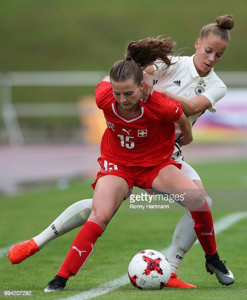 Giulia Gwinn of Germany vies with Kim Dubs of Switzerland during the U19 women's elite round match between Germany and Switzerland at Friedensstadion...
