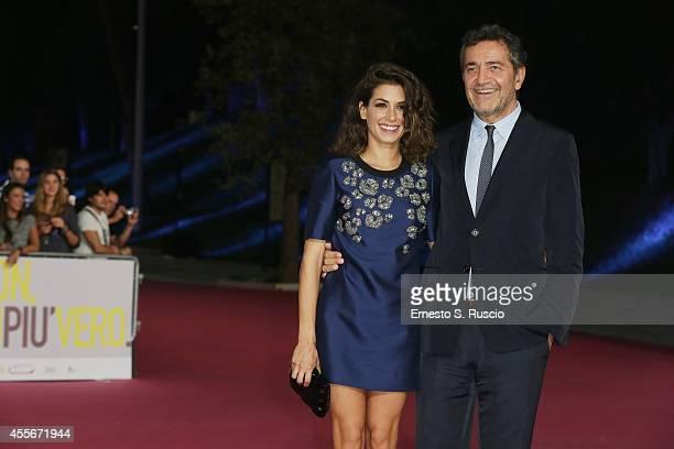 Giulia Michelini and Pietro Valzecchi attend the 'Il Bosco' Pink Carpet as a part of Roma Fiction Fest 2014 at Auditorium Parco Della Musica on...
