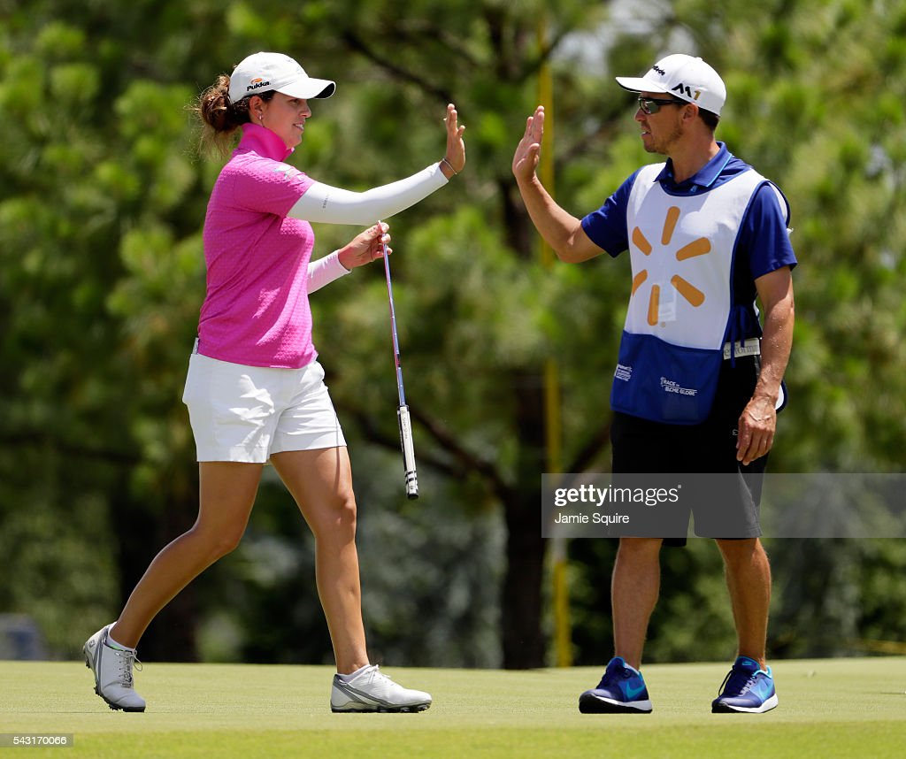Giulia Molinaro of Italy high-fives her caddie after making a putt on the 1st hole during the final round of the Walmart NW Arkansas Championship Presented by P&G on June 26, 2016 at Pinnacle Country Club in Rogers, Arkansas.