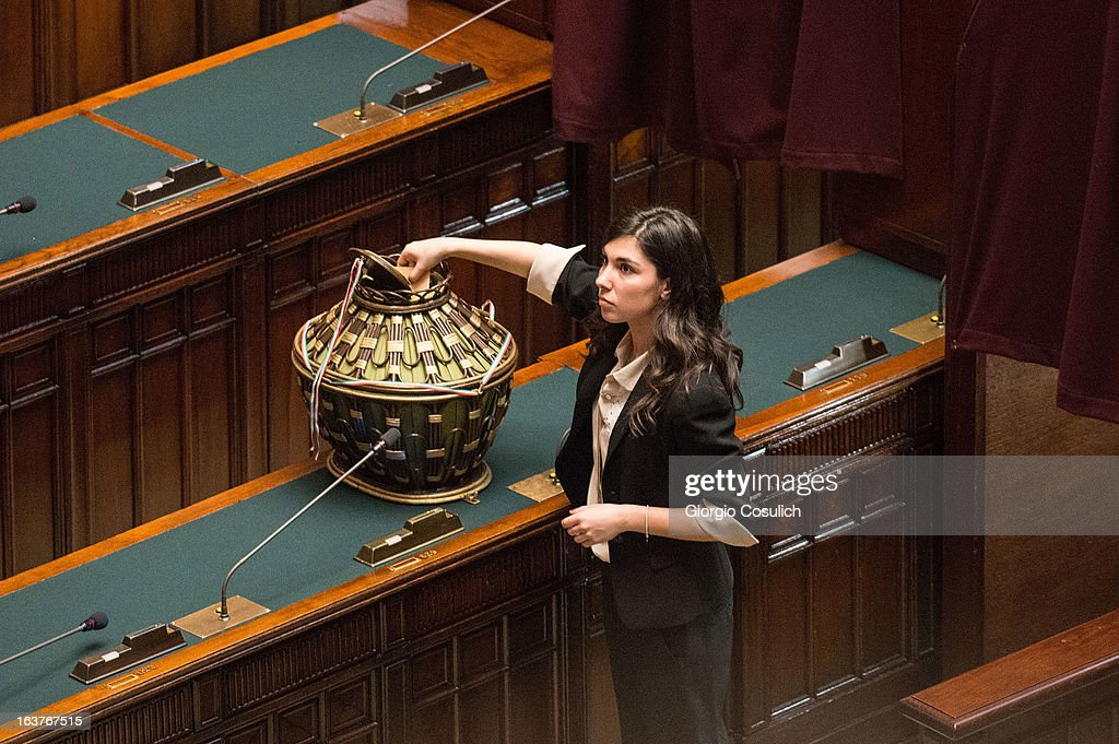 Giulia Sarti, deputy of the Five Stars Movement, places the ballot during the first meeting of the new Italian parliament March 15, 2013 in Rome, Italy. The new Italian parliament opens the 17th Legislature wtth the task of electing the President of the House of Parliament and of the Senate before giving way to a new government. Pier Luigi Bersani, leader of the Democratic Party, asked senators and representatives to enter blank votes to continuing working on an agreement with the 5-Star Movement (M5S).