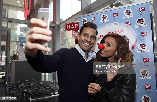 Giuliana Rancic and Bill Rancic share a laugh don red noses and join in on the Red Nose Day fun while visiting their local Walgreens April 22 2015 in...