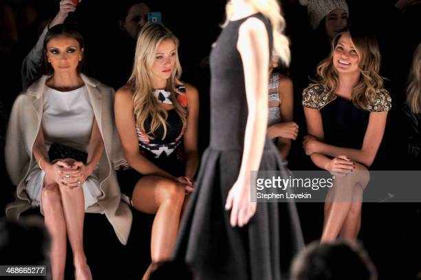 Giuliana Rancic Katrina Bowden and Chrissy Teigen attend the Badgley Mischka fashion show during MercedesBenz Fashion Week Fall 2014 at The Theatre...