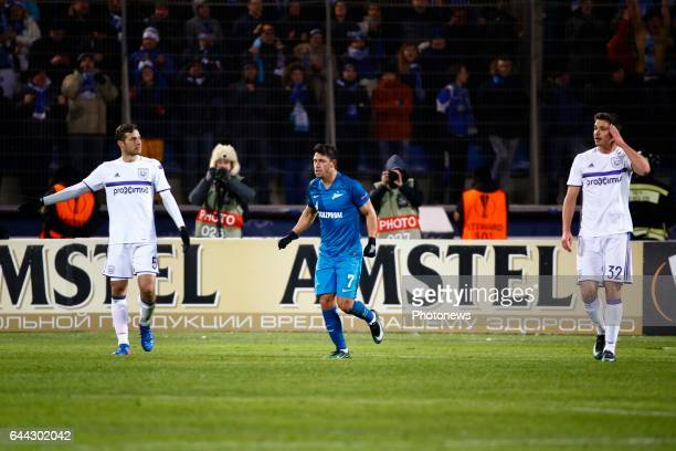 Giuliano forward of FC Zenit celebrates and Uros Spajic defender of RSC Anderlecht and Leander Dendoncker midfielder of RSC Anderlecht during the...
