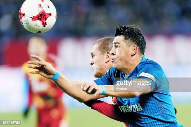 Giuliano of FC Zenit St Petersburg and Alexandru Bourceanu of FC Arsenal Tula vie for the ball during the Russian Football League match between FC...