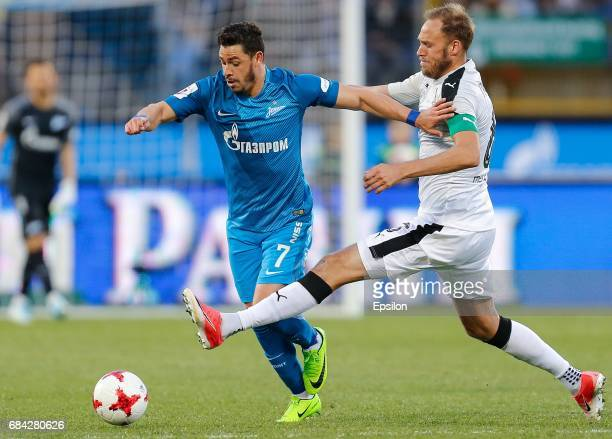 Giuliano of FC Zenit St Petersburg and Andreas Granqvist of FC Krasnodar vie for the ball during the Russian Football League match between FC Zenit...