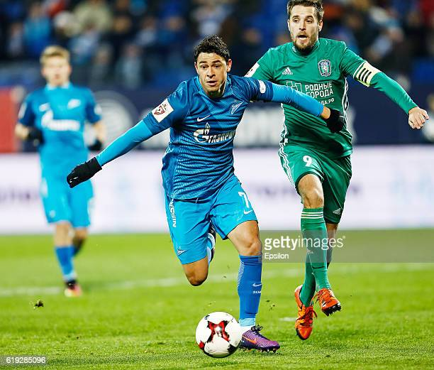 Giuliano of FC Zenit St Petersburg and Kirill Kombarov of FC Tom Tomsk vie for the ball during the Russian Football League match between FC Zenit St...