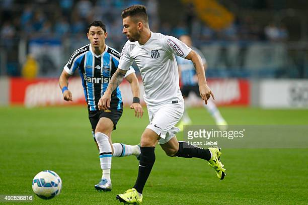 Giuliano of Gremio battles for the ball against Lucas Lima of Santos during the match Gremio v Santos as part of Brasileirao Series A 2015 at Arena...