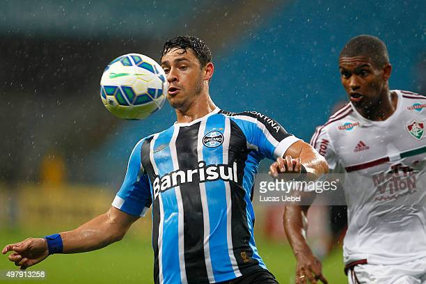 Giuliano of Gremio battles for the ball against Marlon Santos of Fluminense during the match Gremio v Fluminense as part of Brasileirao Series A 2015...