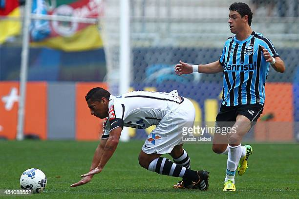 Giuliano of Gremio battles for the ball against Ralf of Corinthians during the match Gremio v Corinthians as part of Brasileirao Series A 2014 at...